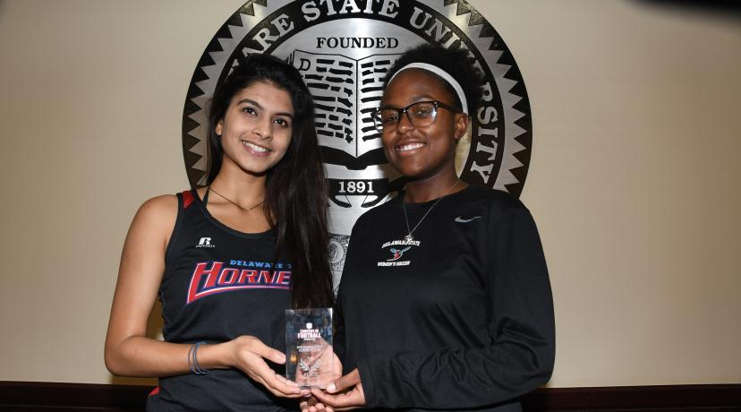 <p>(L-r) Aayushi Chouhan and Braxton Clark represented the University well as they were on the first and second place teams, respectively, in the Business Case Studies Competition at the recent NFL Careers in Football Forum held in Atlanta. The two are holding Ms. Chouhan's first-place trophy (Ms. Clark has already placed her second place trophy in her parent's home).</p>