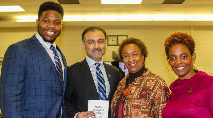 <p>(L-r) Jared Jeffrey, biological sciences major, Dr. Omar Khan of Christiana Care, Dr. Marsha Horton, Dean of the College of Health & Behavioral Sciences, and Dr. Jacqueline Washington, Associate Dean of the same college, pose for a photo after the recent inaugural meeting of the University's Minority Association of Pre-medical Students</p>