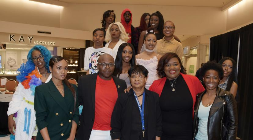 <p>These Textile and Apparel Studies students showed off their fashion designing creations during a April 27 show at the Dover Mall. Dr. Damayanthie Eluwawalage, assistant professor, (bottom row, third from the left), was so impressed by their work, she persuaded the Dover Mall executives to allow student to put on a fashion show there for the public.</p>