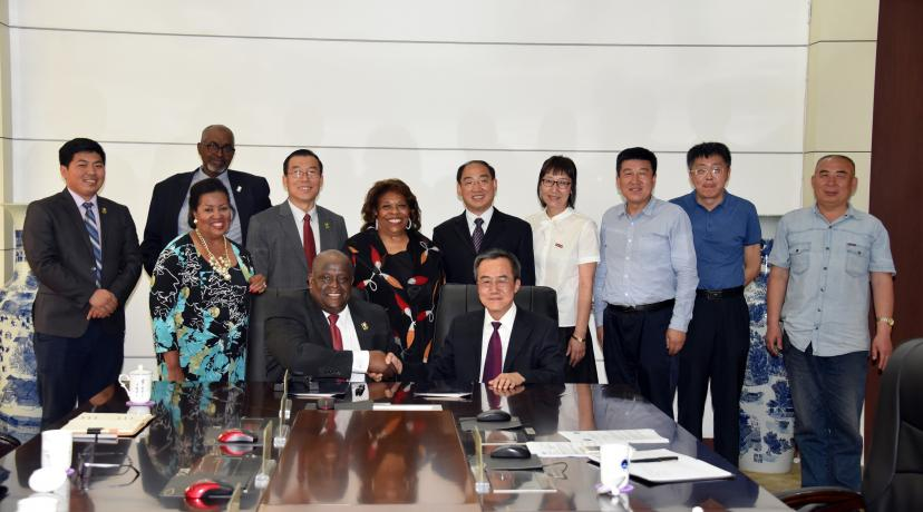 <p>Tony Boyle, Vice President of Strategic Enrollment Management, and JiZong Qi, Vice President of Beihua University of China, shake hands after signing an agreement that establishes a joint English Language Institute in that Far East country.</p>