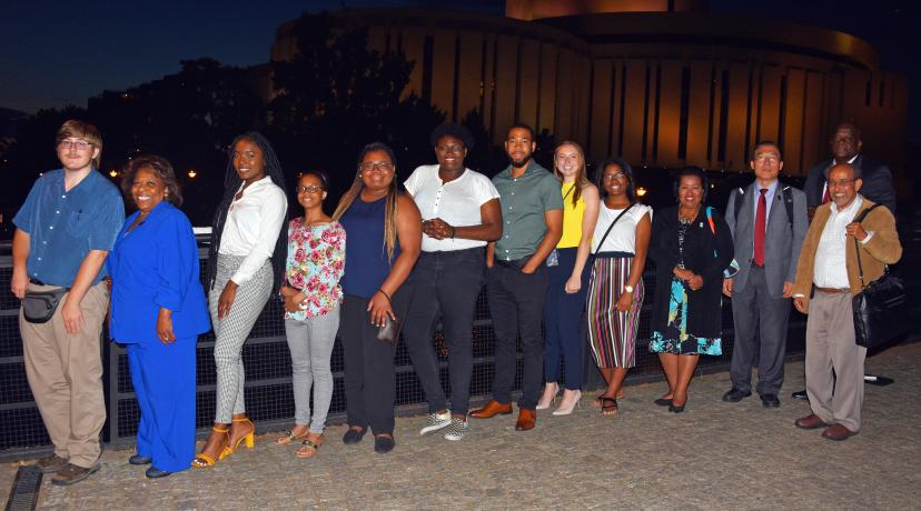 <p>After dinner photo: (l-r) Dominic Morrell, University President Wilma Mishoe, Juliana Paul, Mykia Toney, Destiny King, Kishaye Williams, Corban Weatherspoon, Pamela Schork, Jacori Small, Board of Trustees Chairperson Devona Williams, along with Dr. Fengshan Liu, associate VP of International Affairs, Dr. Mazen Shahin, AMP Director, and Tony Boyle, VP of Strategic Enrollment Management.</p>