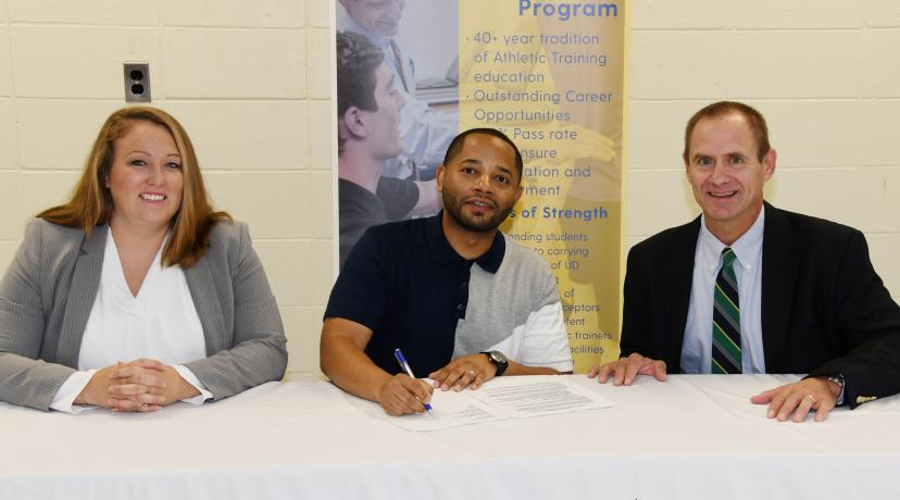 <p>Delaware State University&#039;s Dr. Cara Gomez and Dr. R. Christopher Mason join UD&#039;s Dr. Thomas Kaminski in signing an agreement that will create a pipeline for kinesiology students to enroll in UD&#039;s Athletic Training Master&#039;s Degree Program.</p>