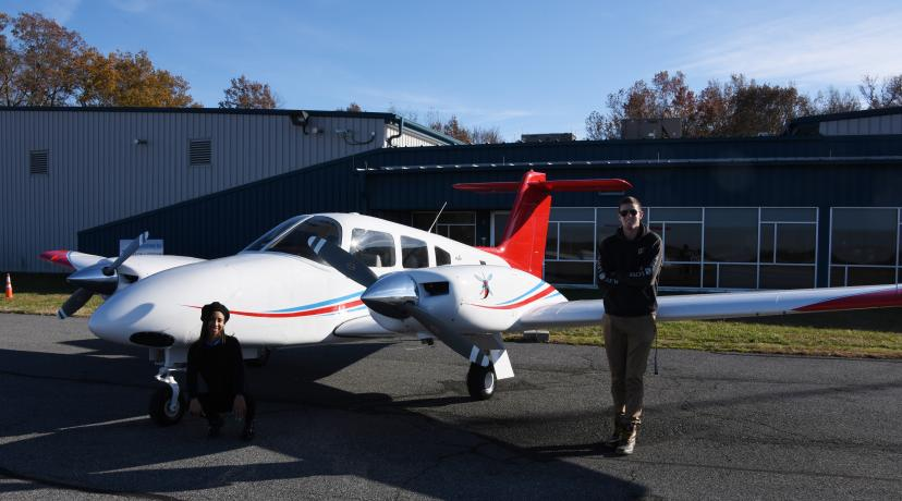 <p>Zaneasia Perry, freshman aviation major, and Lane Deleon, flight instructor and Aviation Program alumnus, pose next to the new twin-engine Piper Seminole recently delivered to the Aviation Program at the Delaware Air Park.</p>