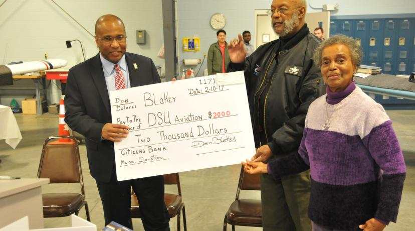 <p>DSU President Harry L. Williams accept a check from Dr. Donald Blakey and his wife Dolores as a kick-off contribution for the newly launched Friends of the DSU Aviation Program fundraising campaign.</p>