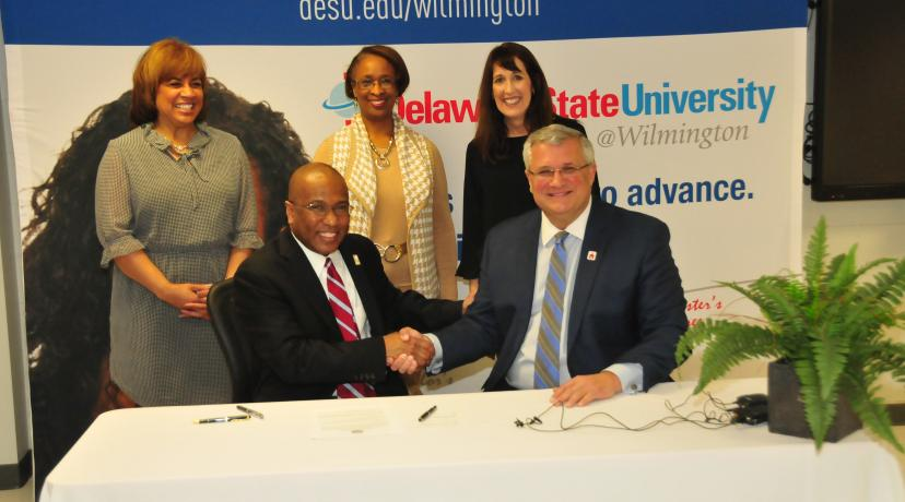 "<p>DSU President Harry L. Williams shakes hands with Red Clay School District Superintendent Merv Daugherty after signing an agreement to offer IT courses to high school students at <a href=""mailto:DSU@Wilmington"">DSU@Wilmington</a>.</p>"