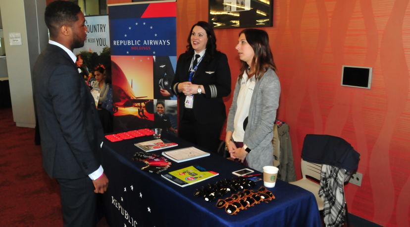<p>A DSU student get some job information from Republic Airways Holdings during the DSU Career Services Career Fair.</p>