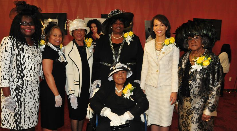<p>The co-chairs of the 2017 First Lady's Hats and Gloves Tea with this year's honorees: (seated in front) Mary Maloy Scott; (standing l-r) Co-chair Enid Wallace-Simms, DSU First Lady Dr. Robin Williams, honorees Dr. Lozelle De Luz, Bernice Edwards, U.S. Rep. Lisa Blunt Rochester, and co-chair Virginia L. Carson.</p>