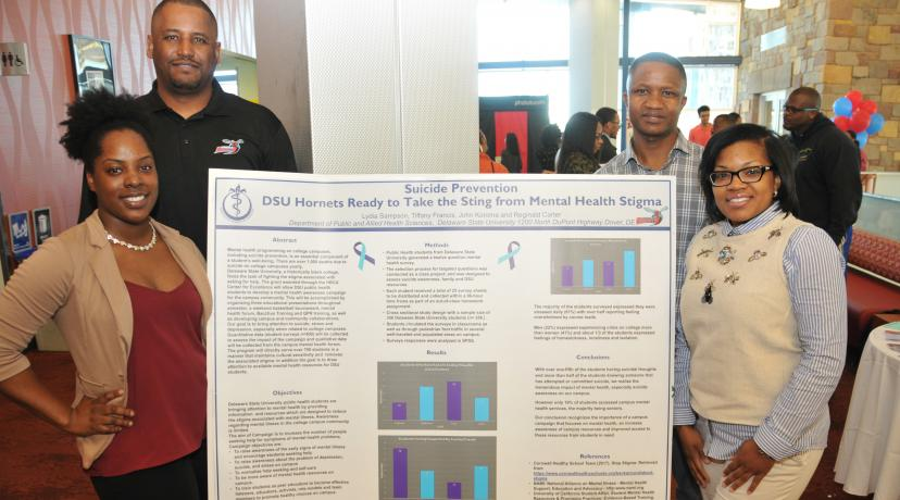 <p>The first-place research poster winning team: (l-r) Lydia Sampson of Lewes, Del., Reginald Carter of Marydel, Md.; John Koroma from Sierra Leone, West Africa, and Tiffany Francis of Middletown, Del. All are senior Public Health majors at DSU.</p>