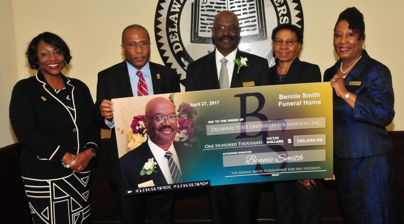 <p>(L-r) Dr. Vita Pickrum, DSU President Harry L. Williams, Bennie and Shirley Smith, as well as Cynthia Williams of Bennie Smith Funeral Homes, pose with a display check representing the newly established endowment.</p>