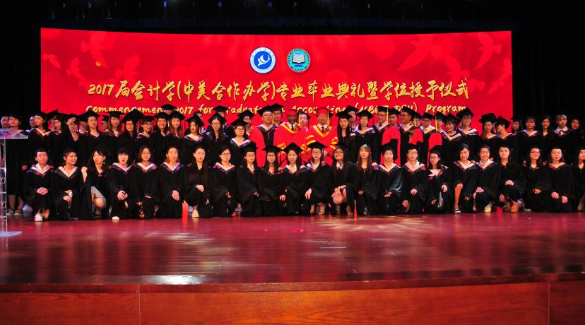 <p>(Center) Dr. Fengshan Liu, DSU President Harry L. Williams and NBUT President Lyn Zhongda pose with the 81-member class of graduates from the DSU-NBUT Accounting Program</p>