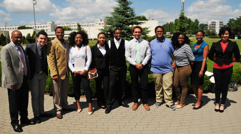 <p>DSU President Harry L. Williams poses with the I-STARS students in Poland</p>