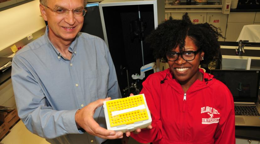 <p>(L-r) Dr. Yuri Markushin, DSU physics researcher, and junior physics major Simone Johnson hold a pet strip invented here at DSU to help dog owners diagnose certain diseases in their pet and thereby save veterinarian costs.</p>