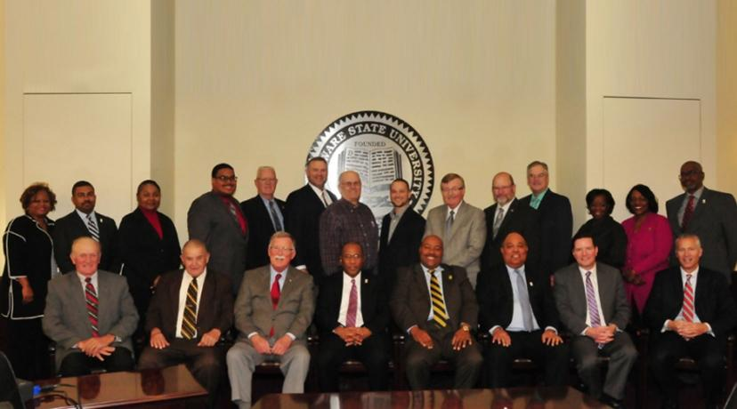 <p>Kent County legislators participate in a photo opp moment with DSU Harry L. Williams, Board of Trustees Chairman David Turner and Vice Chairman Barry Granger along with other University officials.</p>