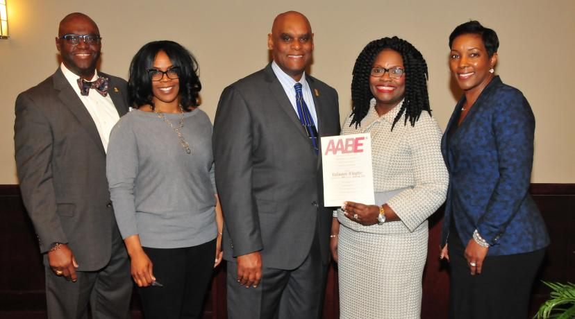 <p>John Allen of Delmarva Power, along with Amber Young, William Pickrum, Enid Wallace-Simms, secretary, vice president and president, respectively; along with Paula Glover, national AABE president/CEO, celebrate the new Delaware AABE Chapter.</p>