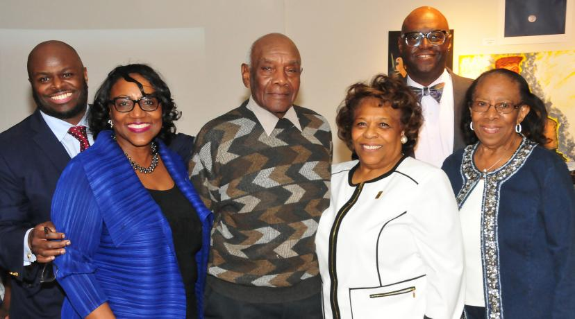 <p>(L-r) Provost Tony Allen, Institutional Advancement VP Vita Pickrum, Douglas Gibson, DSU Acting President Wilma Mishoe, DSU Trustee John Allen and DSU alumna Reba Hollingsworth gather at a reception in honor of Mr. Gibson and his hand-carved duck art. Mr. Gibson donated 10 works to the University.</p>