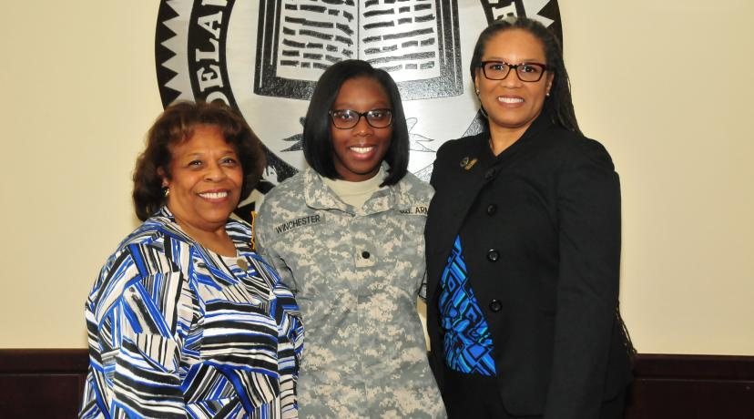 <p>Alisa Winchester (center), a junior English major, stands with DSU Acting President Wilma Mishoe (l) and Dr. Adenike Davidson, professor of English. Just before the photo, Dr. Mishoe informed Ms. Winchester, also a ROTC cadet, that she has been awarded the prestigious Harry W. Truman Scholarship.</p>